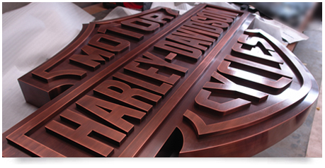 fabricated copper signage aged slightly with corporate logo
