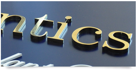 a close up of solid brass letters