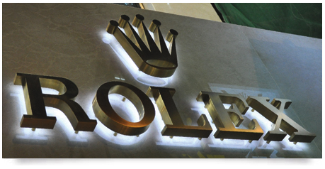 amazing fabricated brass lettering with strong white halo type lighting projecting from inside the lettering