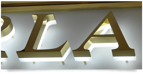 brass sign with illumination under the main lettering in white