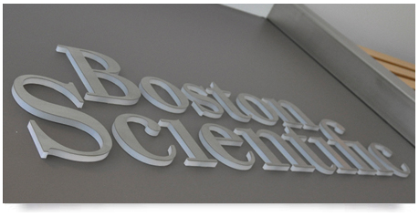 stainless steel letters on a white perspex lettering