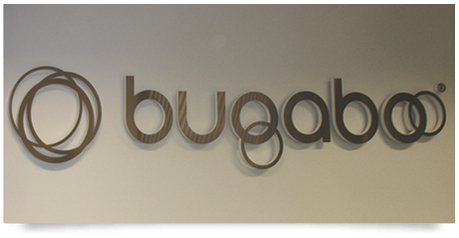 office sign with raised stainless steel letters creating a drop shadow effect