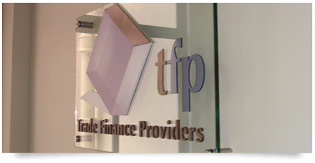 a glass sign with raised letters including a logo which has blends so it required digital printing