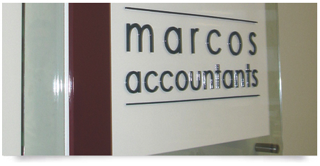 glass sign with 3d lettering mounted the face of the glass and stainless steel bolts holding the sign to the wall