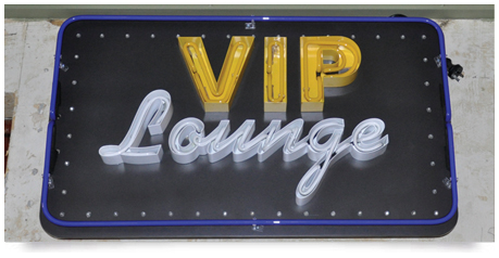 neon signage in fabricated metal lettering