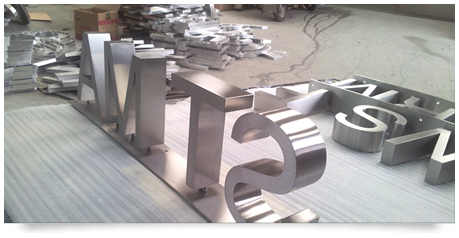 fabricated stainless steel lettering mounted to a base unit