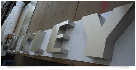 thick fabricated stainless steel lettering on a paper template
