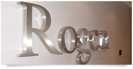 matt linished stainless steel lettering mounted to an office wall