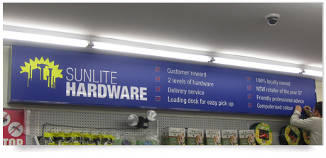 a large indoor lightbox single sided with illuminated graphics inside a retail store