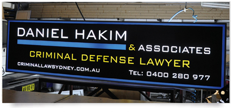 an outdoor lightbox with vinyl translucent graphics